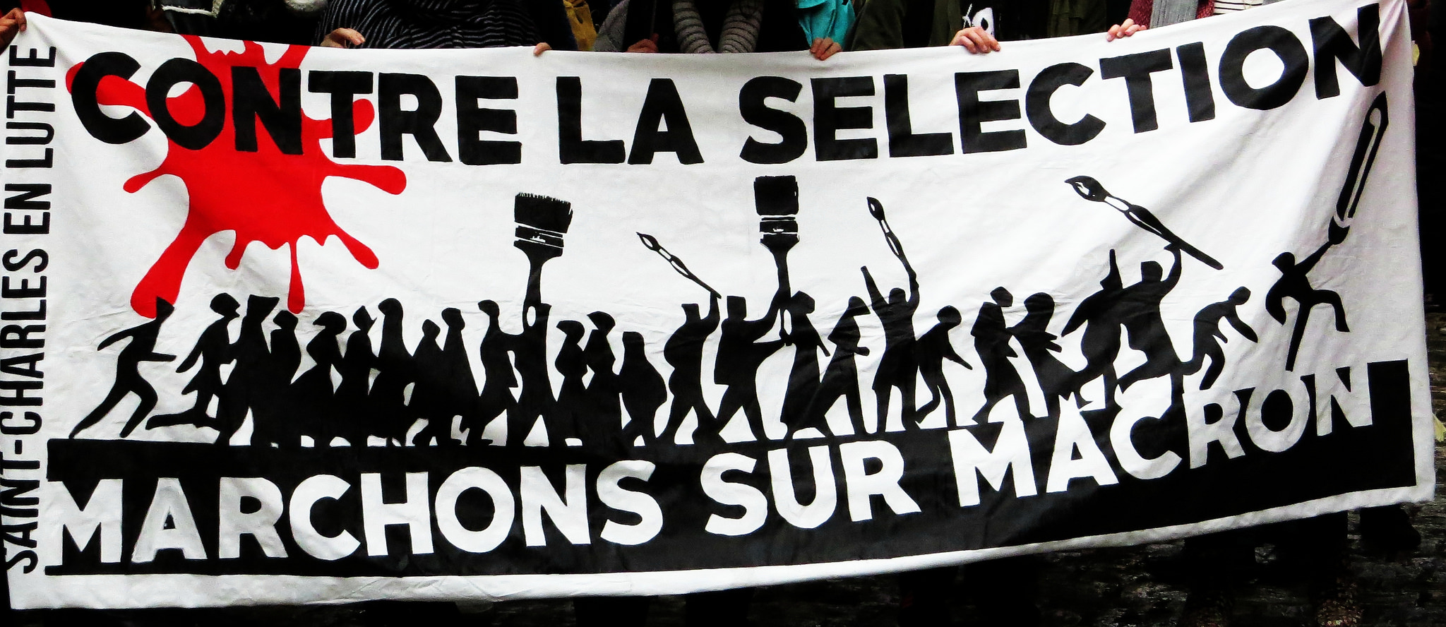 A protest banner that says in French:
