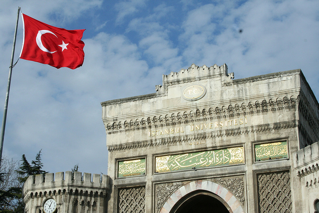 Turkish flag in front of the main entrance of Istanbul University.
