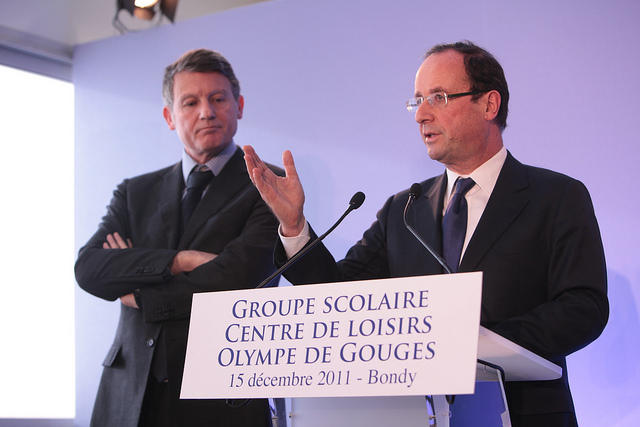 French Minister for Education Vincent Peillon (2012 – 2014) and President François Hollande (2012 – 2017) at a speaker's desk during an event in Bondy, France, on 15.11.2011.